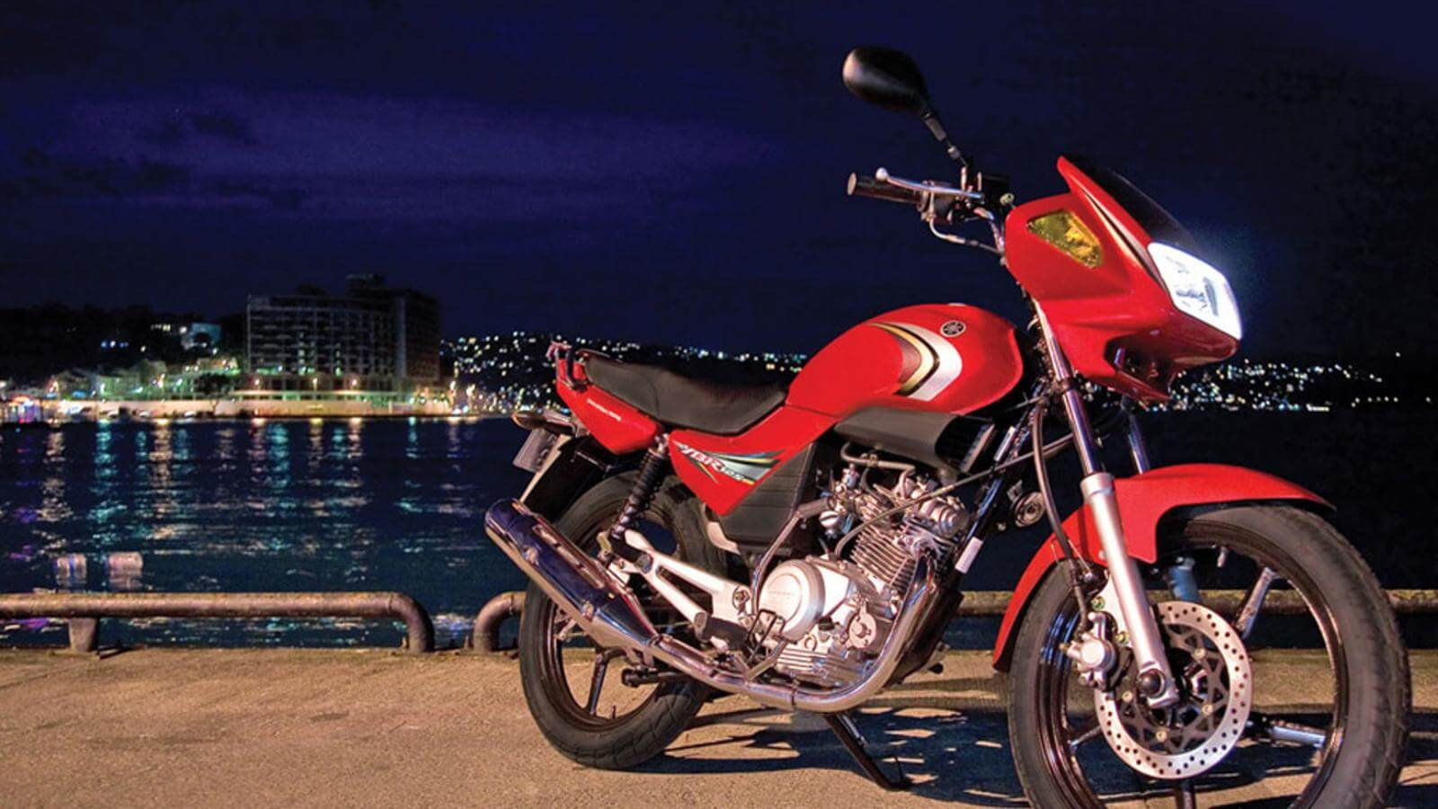 2011-Yamaha-YBR125-RU-Red-Spirit-Action-001.jpg